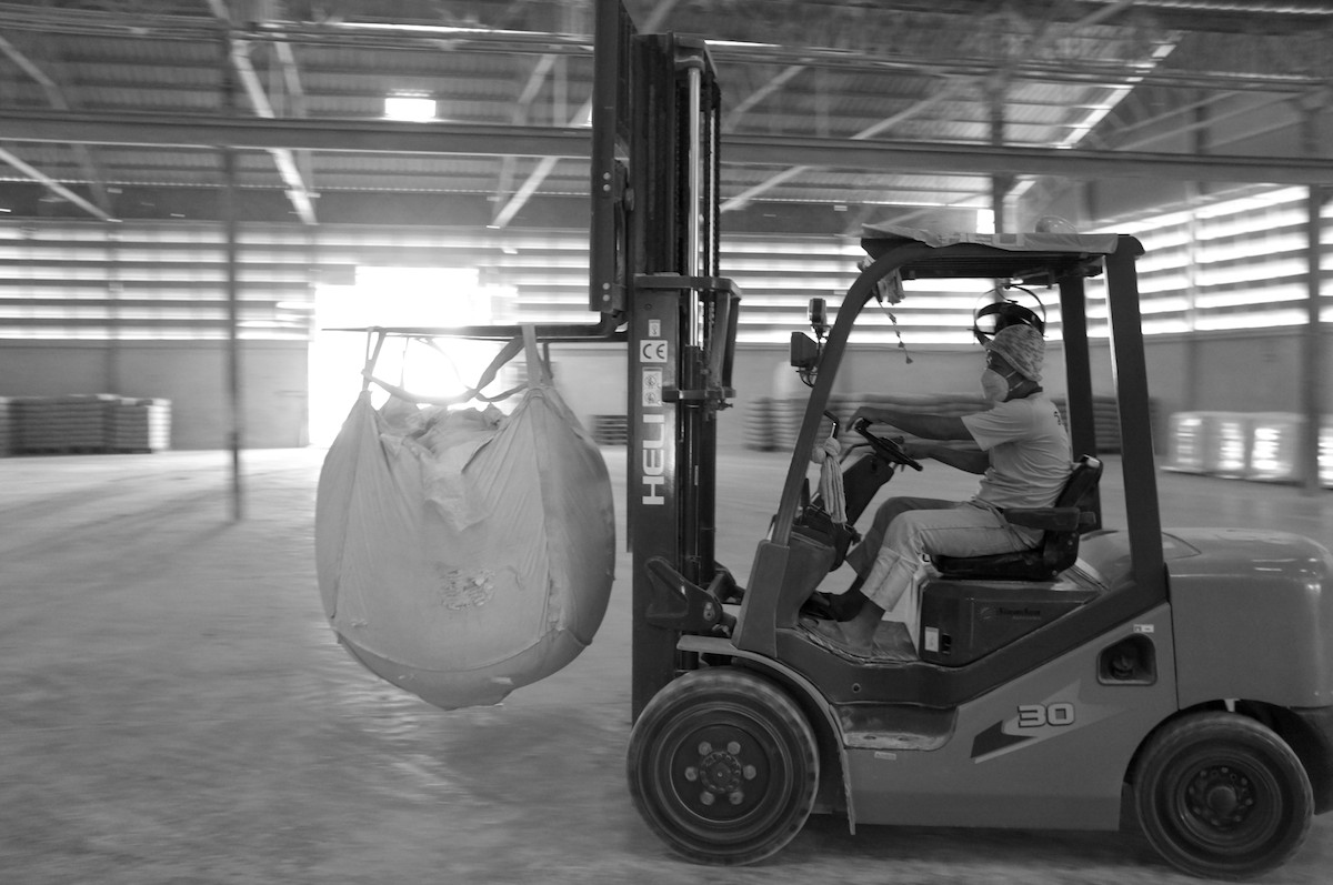 With a recent shipment of kaolin having gone out, the forklift driver has ample room to enjoy a little sliding while transporting the bags ready for shipment.